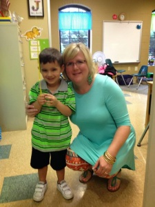 Jennifer Belisle with a student, Photo by Chamblyn Dudley
