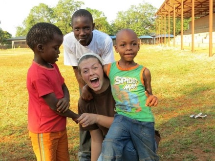 Victoria Layne bonding with three of her South African students during her mission trip.