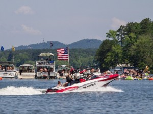 Following the wake surfing competition, a boat flying an American flag passed by the beach prior to the wake boarding competition as the Pledge of Allegiance played.