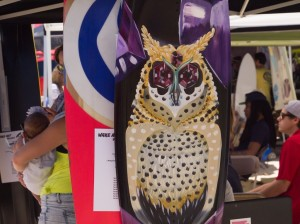 One of the vendors on the beach sold hand-painted wake boards. Many fans were drawn to the custom-made boards due to the unusual paintings, such as an owl on the top of a board.