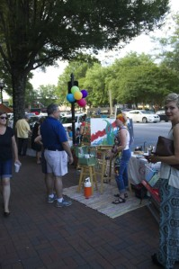 Marietta Square's Art Walk occurs each first Friday of the month. June's Art Walk attracted a diverse crowd of all ages to mingle throughout the art-filled streets provided by local artists, musicians and performers.