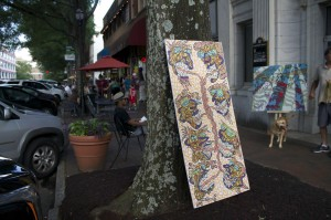 Each artist claimed a small section of the street, leaning their work on the trees or by a wall. The works were diverse, and each turn of the corner provided something new for viewers. All artistic media was considered for the Art Walk, as long as it was original work.