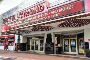 Above the Box Office, The Earl Smith Strand Theatre's sparkling marquee constantly flashes with information about upcoming shows and events. (Photo by Brittany Maher)