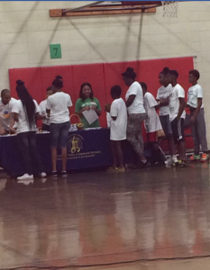 The teens continued to circulate around the recreation gymnasium, picking up more information on different topics at each vendor table. Some of the students asked questions about issues they are facing at school. Photo by Cherrica Fed