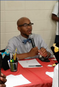 Aaron Brown speaks to the teens during a question and answer segment. He was very passionate about youths choosing a career at an early age. He is the founder of a successful bowtie line. Photo by Cherrica Fed