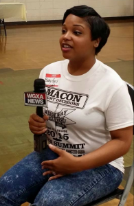 The president, Tanishia Johnson, of Dignified Divas, a volunteer organization in Macon, Georgia, speaks to the news media about what the event is and what the she seeks to accomplish by having the event. She wants to be a part in making a change for the better for the youth in Macon, Georgia. She is the founder of the Georgia chapter of Dignified Divas. Photo by Cherrica Fed