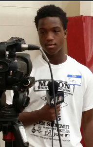 """The news media speaks to one of the young participants about what he hopes to gain from attending The Teen Summit. The teen goes by the name """"Sixty"""" and admits to issues he witnesses every day in school and outside of school. Photo by Cherrica Fed"""