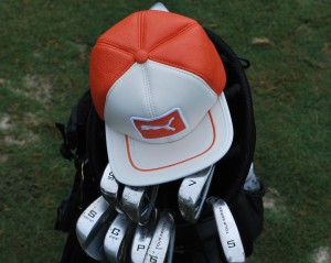 "This cap represents Rickie Fowler, 26, from Murrieta, California, a professional golfer on the PGA Tour, world No. 5, and a big idol for many young golfers, who want to be like him one day. The children like Fowler for his fancy orange Puma outfit, the caps he wears and for his attitude. You will often see a lot of ""junior Fowlers"" on the golf courses. Photo by Mette Pedersen"
